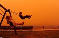 kids swinging in dust storm